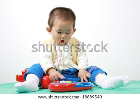 chinese baby playing with toy