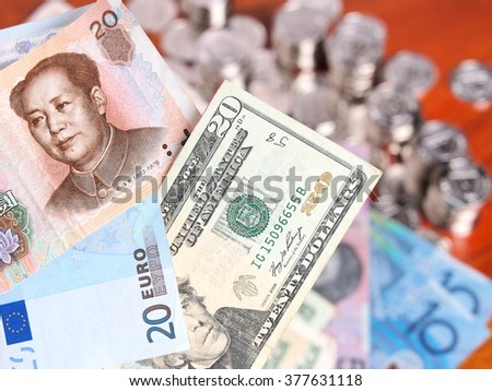 Chinese bank note, 20 Euro and 20 US Dollar notes  - stock photo