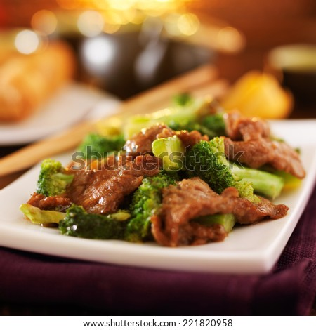chinese beef and broccoli  stir fry in warm light - stock photo