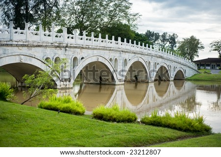 chinese bridge across a river - stock photo