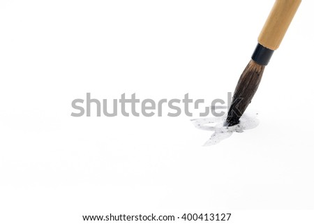 Chinese brushes on white papers