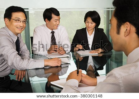 Chinese businesspeople in a meeting - stock photo