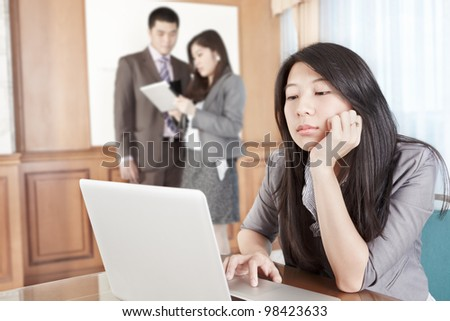 Chinese businesswoman feels bored in the office