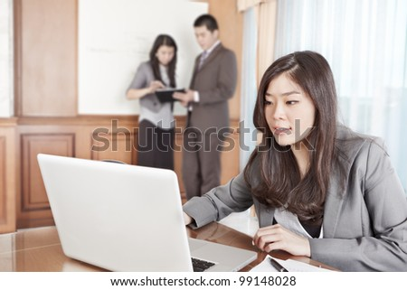 Chinese businesswoman working seriously in the office - stock photo