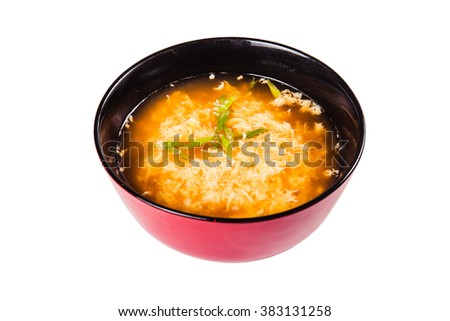 Chinese cheese soup in a round red bowl on a white background