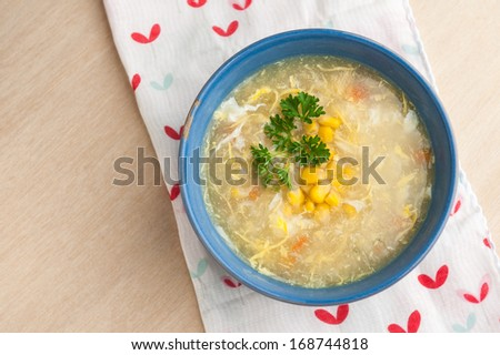 Chinese chicken and corn soup. - stock photo