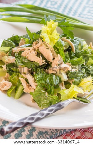 Chinese chicken salad made with shredded chicken and mixed greens with dressing