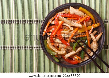 Chinese chicken with vegetables close-up on a plate. horizontal view from above  - stock photo