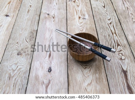 Chinese chopsticks on a wooden Cup