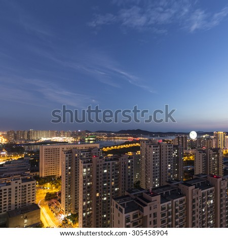Chinese city skyline in the evening - stock photo