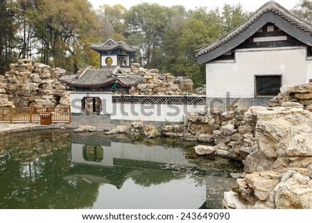 Chinese classical garden, there is a pavilion and ponds, is very beautiful - stock photo