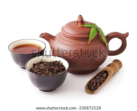 Chinese clay teapot with bowls of puer tea and scoop isolated on white background   - stock photo