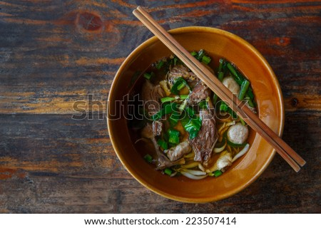 Chinese clear soup in traditional ceramic bowl