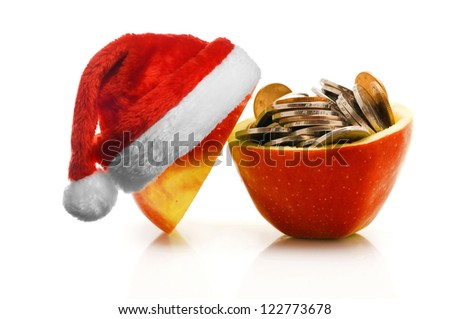 Chinese coins in red apple with santa hat, isolated on white - stock photo