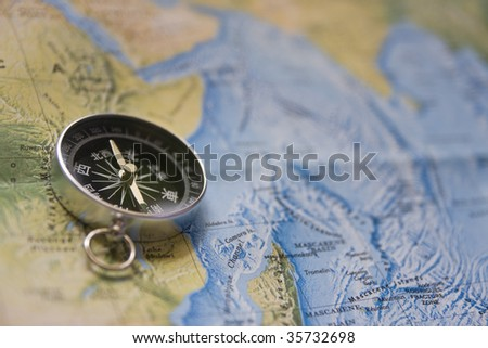 Chinese compass on map - stock photo