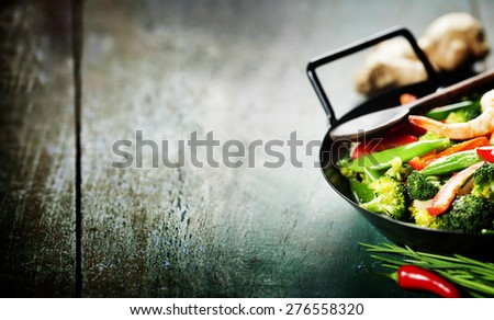 Chinese cuisine. Colorful stir fry in a wok. Shrimps with vegetables - stock photo
