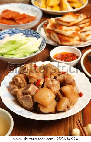 Chinese cuisine - Drunken pig trotters  - stock photo