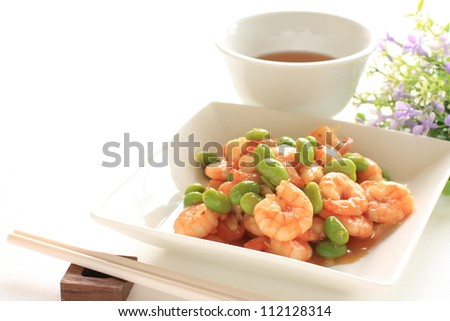 Chinese cuisine, edamame and shrimp stir fried and hot tea - stock photo