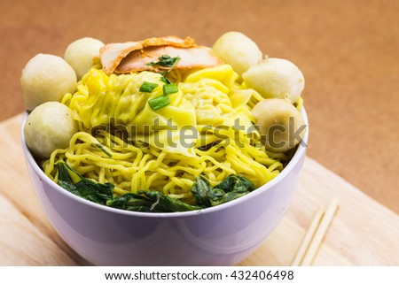 Chinese cuisine, egg noodles ,noodle spicy dumpling with fish balls, Street food,Thailand