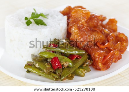 Chinese cuisine. Green beans in Sichuan with rice and pork in sweet and sour sauce