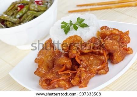 Chinese cuisine. Pork in batter and sweet and sour sauce with green beans in Sichuan