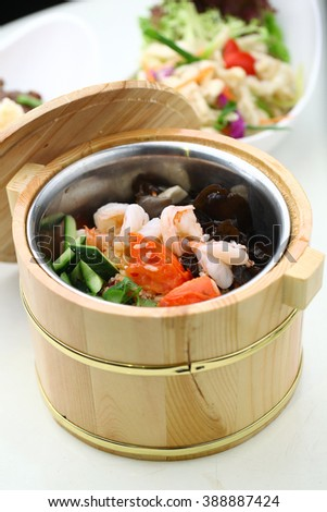 Chinese cuisine served in a thermal food storage