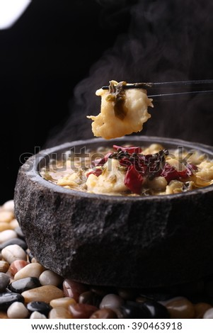 Chinese cuisine served in a unique bowl with rock texture - stock photo