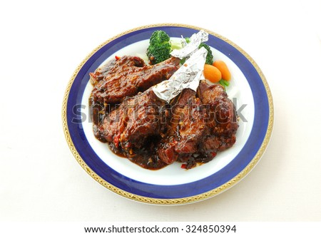 chinese cuisine. yumcha, chinese food. Fried pork chop with sweet and sour sauce.  - stock photo