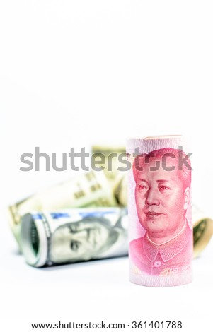 Chinese currency and American dollars roll on white background,Focus on Chinese currency - stock photo