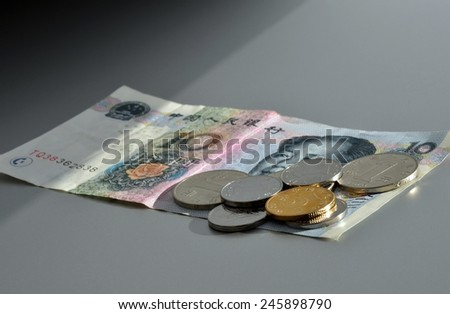 Chinese currency. Coins and ten Yuan bank note. - stock photo