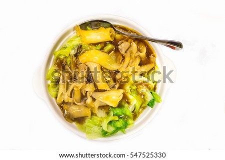 Chinese delicacy braised fish maw with vegetable served in bowl on table