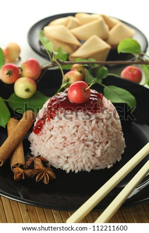 Chinese dessert served with cinnamon and apples - stock photo