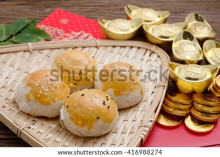 Chinese dessert with red envelope and gold ingots ,chinese new year festival - stock photo