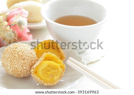 Chinese dim sum, deep fried sesame ball with tea