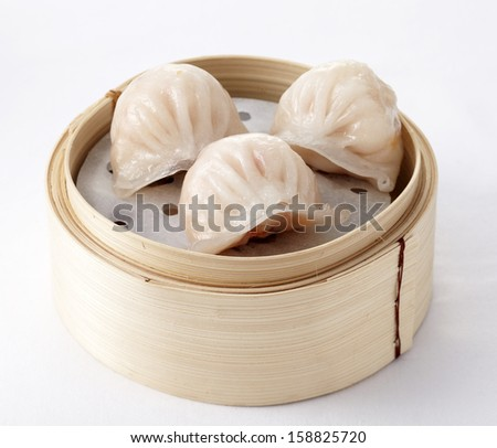 Chinese dim sum 'Hagao' in bamboo basket - stock photo