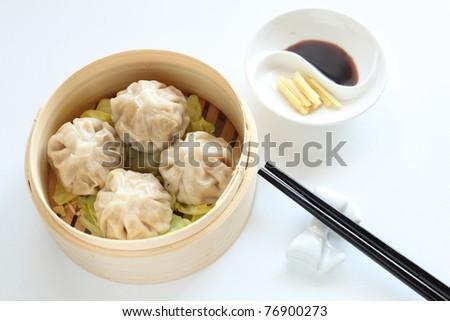 Chinese Dim Sum in bamboo steamer - stock photo