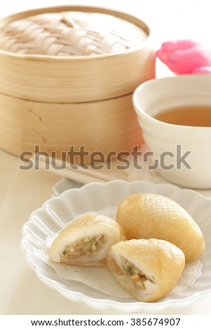 Chinese dim sum, sticky rice flour and vegetable filling dumpling deep dried Haam Seoi Gaau