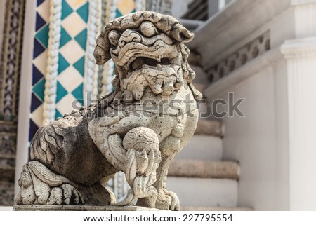 Chinese dog or lion sculpture in Wat Phra Kaew, Temple of the Emerald Buddha, Bangkok, Thailand. - stock photo