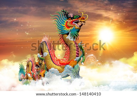 Chinese dragon at sunset in the background - stock photo
