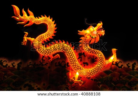Chinese dragon lantern over black background - stock photo