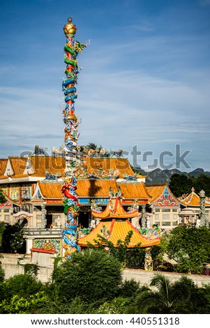 "Chinese dragon on post Statue in chinese temple near river kwai bridge, kanchanaburi, Thailand, The Chinese and Thai text in picture is meaning ""Guan Yin Chapel"". - stock photo"