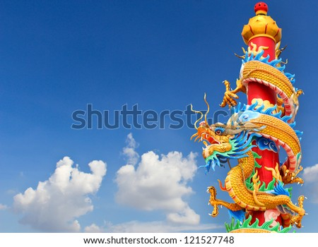 Chinese dragon statue on blue sky - stock photo