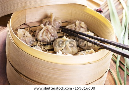 chinese dumpling with filling  - stock photo