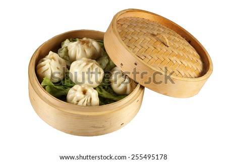 chinese dumplings in bamboo steamer isolated - stock photo