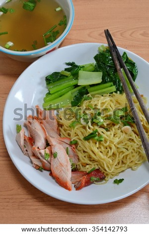 Chinese egg noodle with barbecue pork and soup