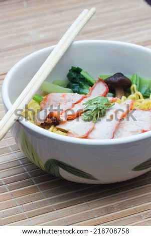 Chinese egg noodles with red pork in hot soup
