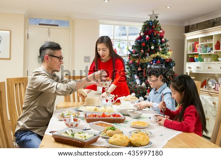 Chinese Family Enjoying Their Christmas Dinner They Are Eating Traditional Food The