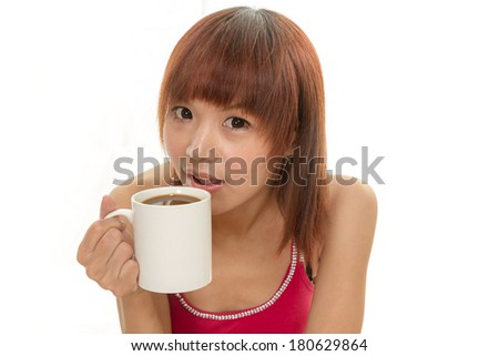 Chinese female in red dress with coffee cup - stock photo