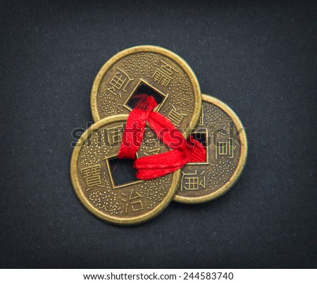 Chinese feng shui coins for good fortune and success. - stock photo