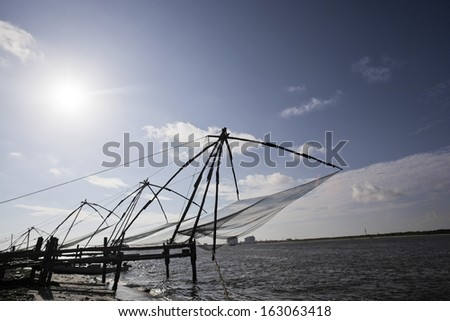Chinese fishing nets at a harbor, Cochin, Kerala, India - stock photo